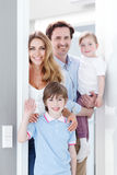 Happy family inside house Stock Photos