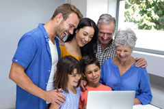 Happy family interacting using laptop Royalty Free Stock Images