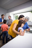 Happy family interacting using laptop Royalty Free Stock Photography