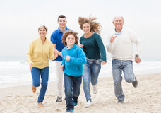 Happy family jogging atthe beach Stock Images