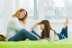 Happy family. joyful contented mother stroking her daughter's hair Royalty Free Stock Images
