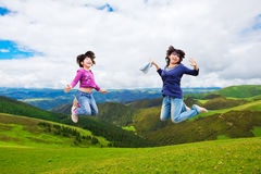 Happy family jump. Happy family (mother and daughter) jump over the mountains into the sky Stock Photography