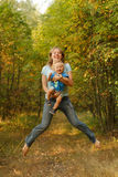 Happy family jump. Mother and baby jumping from happiness and joy in summer nature Stock Image