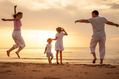 Happy family jumping on the beach Royalty Free Stock Photos