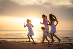 Happy family jumping on the beach Stock Images