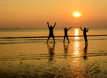 Happy family jumping royalty free stock photography