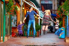 Happy family jumping on colorful street Stock Photography