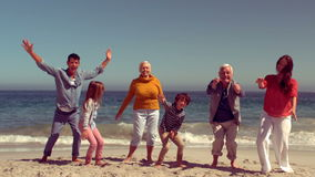 Happy family jumping with hands up stock footage