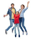 Happy family jumping over white background. Family, motion and people concept - happy smiling mother, father and little daughter jumping over white background stock photos