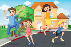 A happy family jumping in the street Stock Images