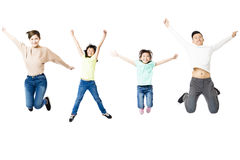 Happy family jumping together isolated on white Stock Photos