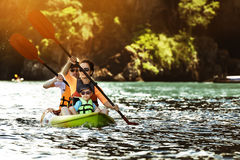 Happy family kayaking at tropical islands royalty free stock image