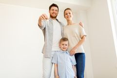 Happy family with key moving to new home Royalty Free Stock Photos