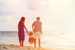 Happy family with kid having fun on sunset beach Royalty Free Stock Image
