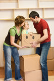 Happy family with a kid moving into a new home Stock Image