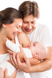 Happy family with the kid over white background Stock Images