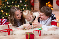 Happy family with kid son have a fun pastime near Royalty Free Stock Image