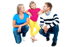 Happy family with kid together isolated on white Stock Photography