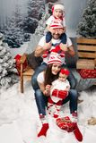 Happy family with kids at Christmas time. stock photo