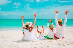 Happy family with kids hands up on beach. Family travel beach royalty free stock photography