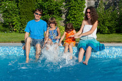Happy family with kids having fun near pool on vacation Royalty Free Stock Photography