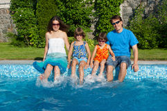 Happy family with kids having fun near pool on vacation Royalty Free Stock Photo