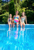 Happy family with kids having fun in swimming pool on vacation. Underwater and above view Stock Photo