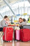 Happy family and kids having sandwich food. In airport restaurant before the flight royalty free stock images