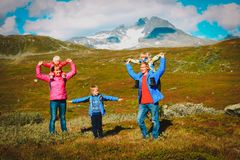 Happy family with kids hiking travel in mountains. Norway, Europe royalty free stock images