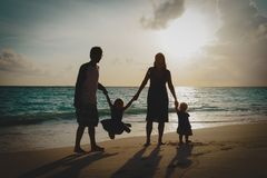 Happy family with kids on play on sunset beach. Happy family with kids on play on sunset tropical beach royalty free stock images