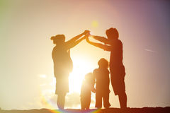 Happy family with kids and pregnant mother together at sunset Royalty Free Stock Image