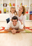 Happy family in the kids room Stock Image