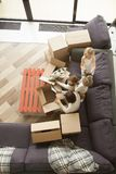 Happy family and kids unpacking boxes moving in, top view Royalty Free Stock Image