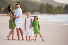 Happy family with kids walk on the beach at sunset. Happy beautiful family on white beach having fun Stock Image