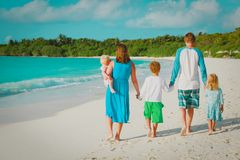 Happy family with kids walk on tropical beach stock image