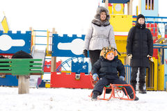 Happy family in a kids winter playground Royalty Free Stock Photo