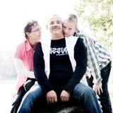 Happy family kiss Stock Photo
