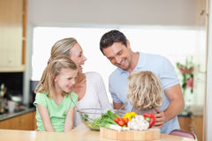 Happy family in the kitchen Royalty Free Stock Photos