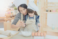 Happy family in the kitchen. Stock Photography