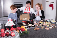 Happy family in the kitchen doing the christmas baking Stock Image