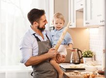 Happy family in kitchen. father and child baking cookies Stock Images