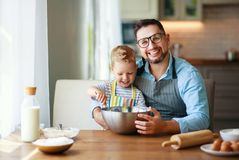 Happy family in kitchen. father and child baking cookies stock photo