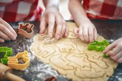 Happy family in the kitchen. Happy loving family are preparing bakery together. Mother and child daughter girl are cooking cookies and having fun in the kitchen royalty free stock image