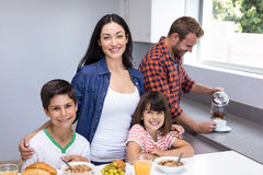 Happy family in kitchen Stock Image
