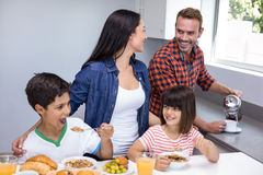 Happy family in kitchen Stock Images