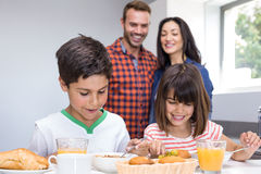 Happy family in kitchen Royalty Free Stock Photos
