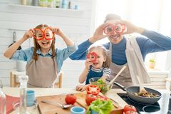 Happy family in the kitchen stock photography