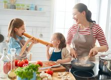 Happy family in the kitchen stock photo