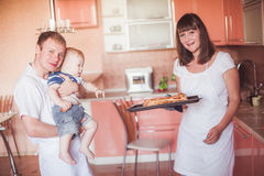 Happy family at kitchen Stock Photography