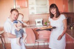 Happy family at kitchen Stock Photography